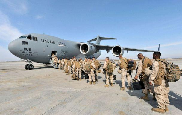 PHOTO: US Soldiers from the 1st Marine Expeditionary Force Pendleton camp bound for Helmand, Afghanistan board their flight at the Manas Transit Center, March 6, 2010. (Vyacheslav Oseledko/AFP/Getty Images, FILE)