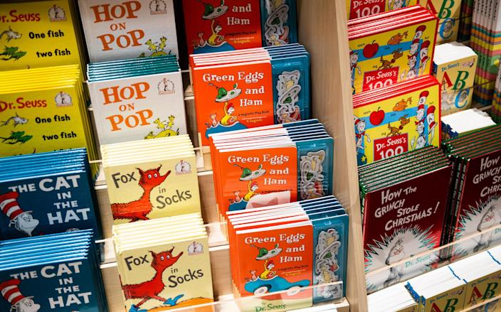 Dr. Seuss books on a shelf at Toys R Us in 2019.  / Credit: Mark Kauzlarich/Bloomberg via Getty