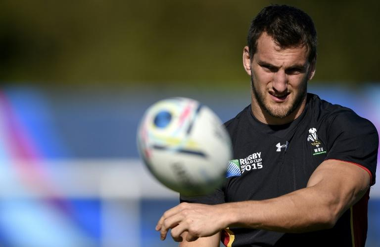 Wales' back row and captiain Sam Warburton catches the ball during a training session at the Hazelwood training centre in London on September 25, 2015