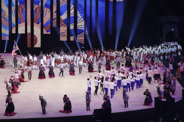 Malaysia;s delegates enter during the opening ceremony of the 30th South East Asian Games at the Philippine Arena, Bulacan province, northern Philippines on Saturday, Nov. 30, 2019. (AP Photo/Aaron Favila)