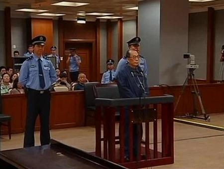 Still image taken from video of China's former railways minister, Liu, attending a trial for charges of corruption and abuse of power at a courthouse in Beijing