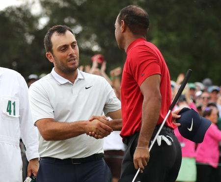 Golf - Masters - Augusta National Golf Club - Augusta, Georgia, U.S. - April 14, 2019. Tiger Woods of the U.S. shakes hands with Francesco Molinari of Italy as he celebrates on the 18th hole to win the 2019 Masters. REUTERS/Lucy Nicholson
