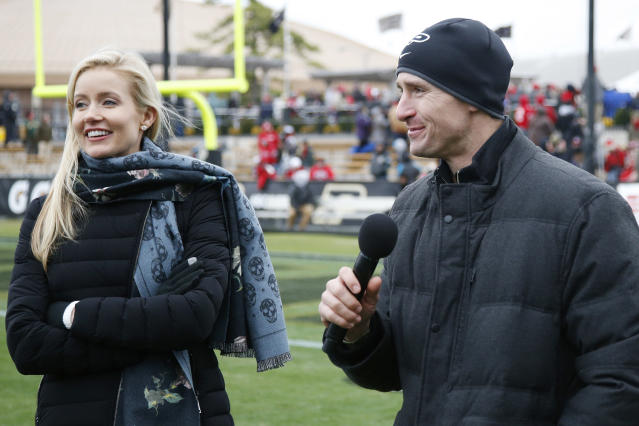 "Saints quarterback <a class=""link rapid-noclick-resp"" href=""/nfl/players/5479/"" data-ylk=""slk:Drew Brees"">Drew Brees</a> and his wife Brittany, pictured in November at a Purdue-Wisconsin game in Indiana, have contributed to the cause against the coronavirus. (Photo by Joe Robbins/Getty Images)"