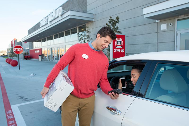 A Target associate bringing an online order to a customer's car