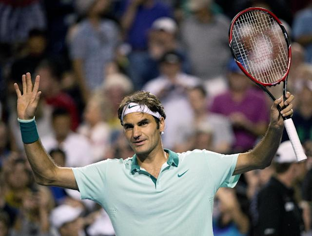 Roger Federer, of Switzerland, reacts to the crowed after defeating Feliciano Lopez, of Spain, at the Rogers Cup tennis tournament, Saturday, Aug. 9, 2014 in Toronto. (AP Photo/The Canadian Press, Nathan Denette)