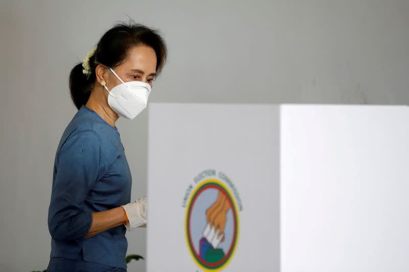 FILE PHOTO: Myanmar State Counselor Aung San Suu Kyi arrives for an early vote ahead of the November 8 general election in Naypyitaw