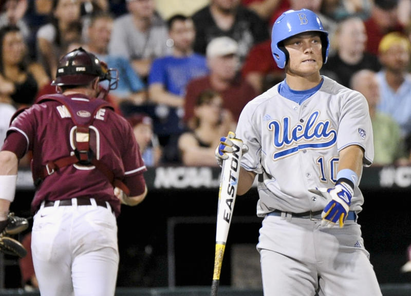 UCLA's Pat Valaika, right, reacts after Florida State pitcher Scott Sitz strikes him out to end the inning with bases loaded, in the sixth inning of an NCAA College World Series elimination baseball game in Omaha, Neb., Tuesday, June 19, 2012. (AP Photo/Ted Kirk)