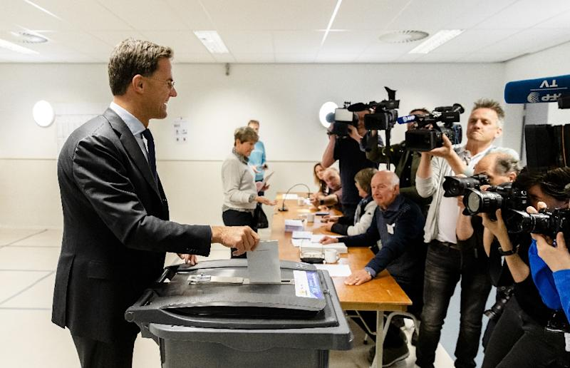 Dutch Prime Minister Mark Rutte casts his vote for the European elections with exit polls due late Thursday and official results out on Sunday (AFP Photo/Bart Maat)