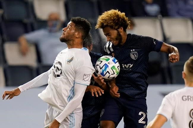 Johnny Russell lifts Sporting KC past Minnesota United, 1-0