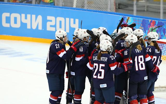 SOCHI, RUSSIA - FEBRUARY 08: The United States celebrate after defeating Finland 3 to1 in their Women's Ice Hockey Preliminary Round Group A Game on day 1 of the Sochi 2014 Winter Olympics at Shayba Arena on February 8, 2014 in Sochi, Russia. (Photo by Martin Rose/Getty Images)