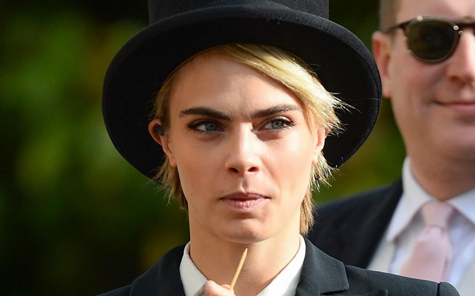 Cara Delevingne attended the wedding of Princess Eugenie of York and Jack Brooksbank in top hat and tails - Pool/Samir Hussein/WireImage