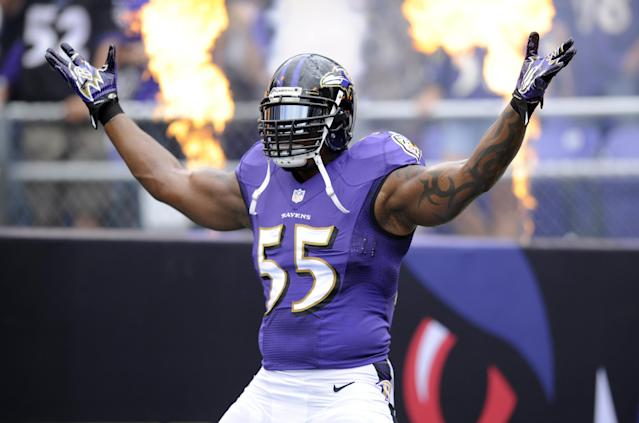 FILE - In this file photo from Sept. 22, 2013, Baltimore Ravens outside linebacker Terrell Suggs is introduced before an NFL football game in Baltimore. The Ravens announced, Monday, Feb. 17, 2014, Suggs signed a four-year extension with the team. His extension with saves the Ravens salary cap room and puts the linebacker in position to finish his career in Baltimore. Suggs, 31, signed a six-year deal in 2009 that expired after the 2014 season. Now he's signed through 2018. (AP Photo/Nick Wass, File)