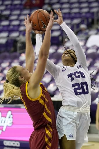 Iowa State guard Madison Wise (1) defends as TCU guard Lauren Heard (20) goes up fo a shot in the second half of an NCAA college basketball game in Fort Worth, Texas, Wednesday, Dec. 2, 2020. (AP Photo/Tony Gutierrez)