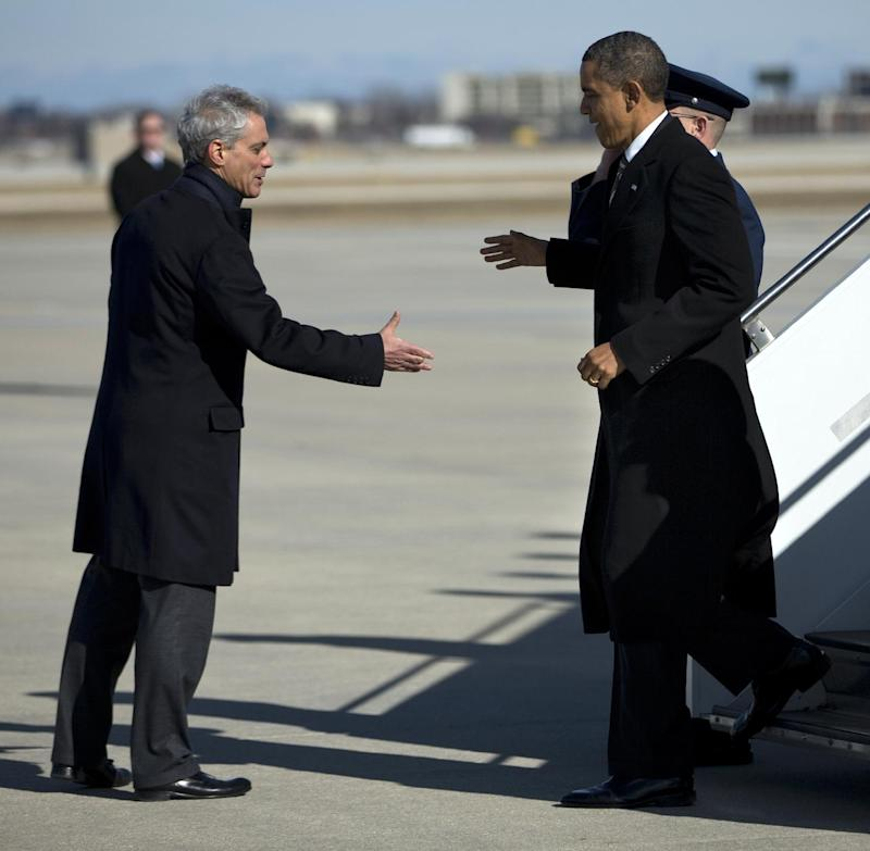 """President Barack Obama, right, is greeted by Chicago Mayor Rahm Emanuel after arriving at Chicago O'Hare International Airport in Chicago, Friday, Feb. 15, 2013. The president Obama went to Chicago to pitch his """"Ladders of opportunity"""" economic plan that he laid out in his State of the Union address.  (AP Photo/Evan Vucci)"""