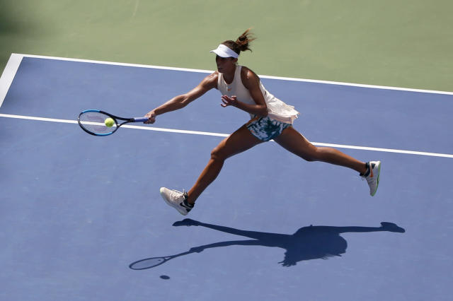 Madison Keys returns a shot to Aleksandra Krunic, of Serbia, during the third round of the U.S. Open tennis tournament, Saturday, Sept. 1, 2018, in New York. (AP Photo/Jason DeCrow)