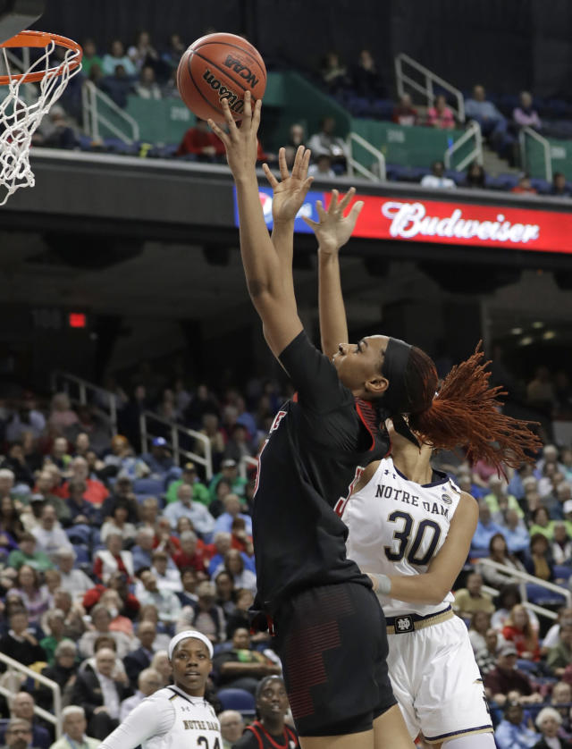 Louisville's Bionca Dunham, left, shoots against Notre Dame's Mikayla Vaughn (30) during the first half of an NCAA college basketball game in the championship of the Atlantic Coast Conference women's tournament in Greensboro, N.C., Sunday, March 10, 2019. (AP Photo/Chuck Burton)