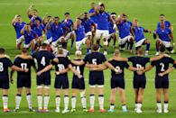 """Like the All Blacks' Haka, Samoa perform the Siva Tau before every game, and here Cameron Spencer (Getty Images) captures the warlike ritual in all its glory. He says: """"In this shot I went up in the stands and shot front on to them on the EF 400mm f/2.8 which I think shows the emotion nicely as Scotland look on in the foreground."""" Scotland weren't phased, running out 34 - 0 winners."""