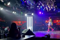 A dancer performs at a nightclub in Dubai, United Arab Emirates, Thursday, Nov. 5, 2020. As the coronavirus pandemic mutes Dubai's live-music scene, the Filipino show bands that long have animated the city's storied nightlife are being disproportionately squeezed. Many are out of work and out of money, struggling to survive in overcrowded dormitories at the mercy of employers (AP Photo/Kamran Jebreili)