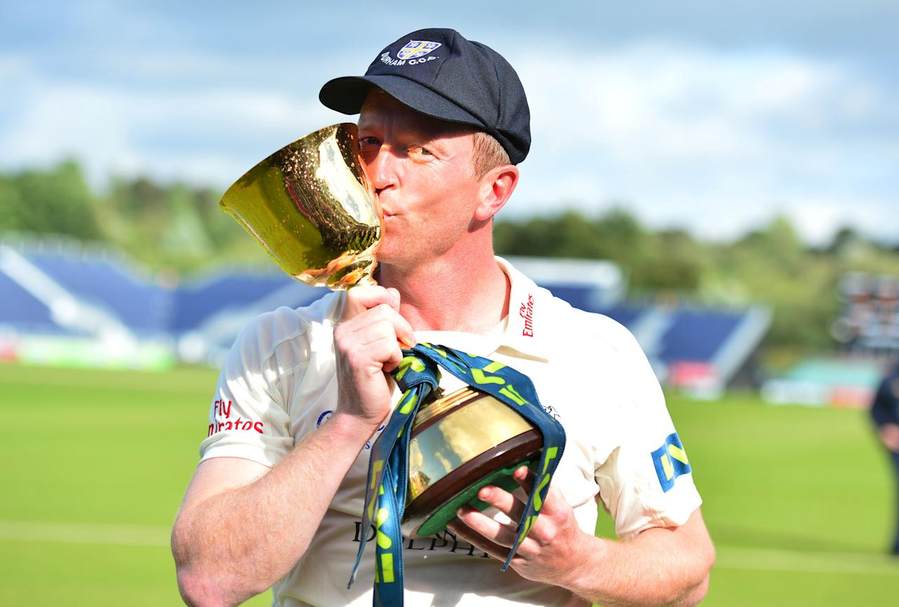Durham captain Paul Collingwood kisses the trophy after winning the LV= County Championship Division One at the Emirates Durham ICG, Chester-Le-Street.