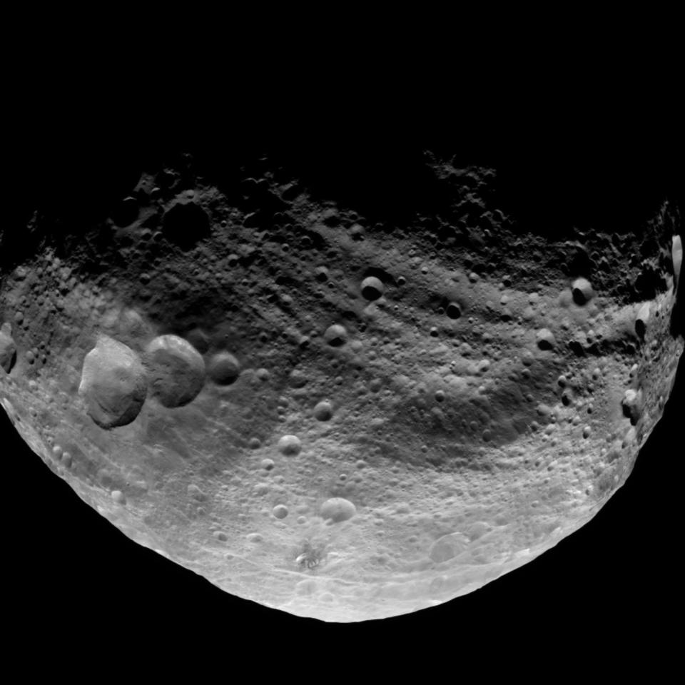 In this image provided by NASA which was obtained by the Dawn spacecraft with its framing camera on Saturday July 23, 2011. It was taken from a distance of about 3,200 miles (5,200 kilometers) away from the giant asteroid Vesta. Dawn took this image over Vesta's northern hemisphere after the spacecraft completed its first passage over the dark side of the giant asteroid. It is northern hemisphere winter on Vesta now, so its north pole is in deep shadow. (AP Photo/NASA/JPL)