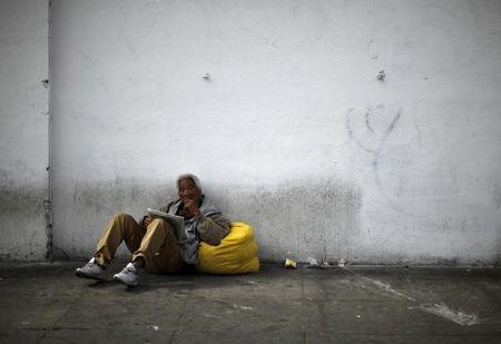 A man sits on downtown Los Angeles' Skid Row