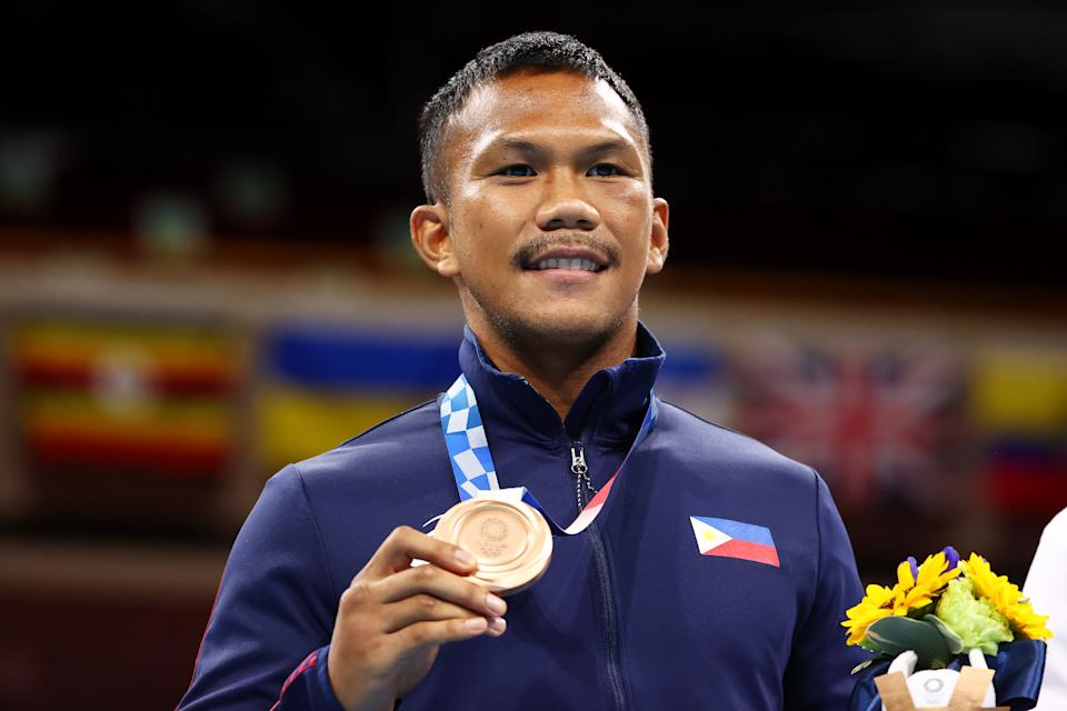 Eumir Marcial of the Philippines poses for a photo with his bronze medal during the medal ceremony for the men's middleweight division at the 2020 Tokyo Olympics.