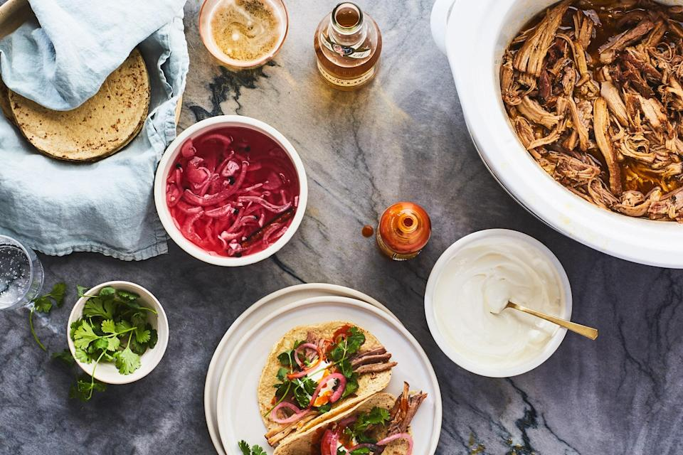 """Nothing is as blissfully hands-off as dinner made in a <a href=""""https://www.epicurious.com/expert-advice/best-slow-cooker-article?mbid=synd_yahoo_rss"""" rel=""""nofollow noopener"""" target=""""_blank"""" data-ylk=""""slk:slow cooker"""" class=""""link rapid-noclick-resp"""">slow cooker</a>. This pork takes between eight and ten hours, during which time you can decide whether to stuff it into tacos, or throw it into a <a href=""""https://www.epicurious.com/recipes/food/views/nextover-chile-orange-pork-stir-fry?mbid=synd_yahoo_rss"""" rel=""""nofollow noopener"""" target=""""_blank"""" data-ylk=""""slk:chile-orange stir-fry"""" class=""""link rapid-noclick-resp"""">chile-orange stir-fry</a>. <a href=""""https://www.epicurious.com/recipes/food/views/slow-cooker-chipotle-orange-pork-tacos?mbid=synd_yahoo_rss"""" rel=""""nofollow noopener"""" target=""""_blank"""" data-ylk=""""slk:See recipe."""" class=""""link rapid-noclick-resp"""">See recipe.</a>"""