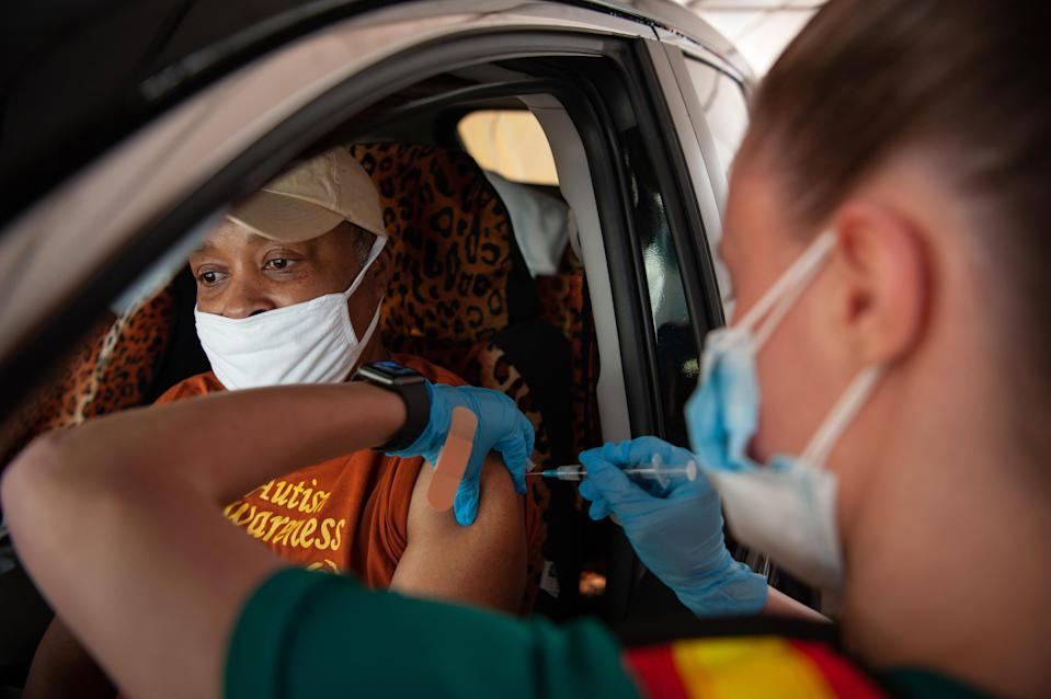 Allisa White receives her Moderna vaccine at a drive-thru site on the campus of Delta State University in Cleveland, Miss., on March 16, 2021. (Rory Doyle/The New York Times)