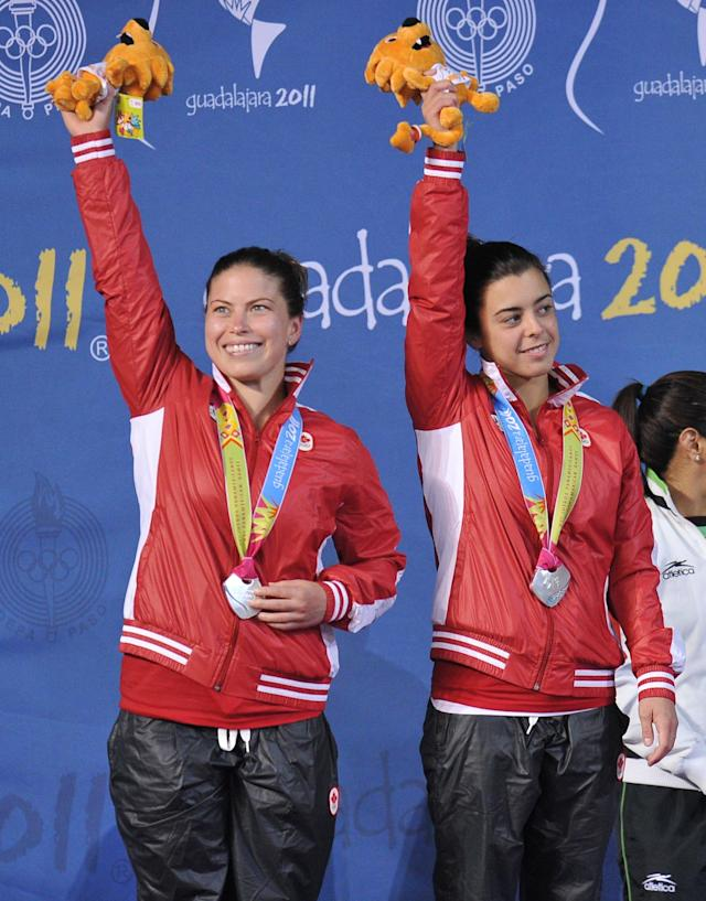 Canadian Meaghan Benfeito (L) and Roseline Filion pose on the podium with the silver medal of the women´s 10m synchronised platform during the XVI Pan American Games Guadalajara 2011 in Guadalajara, Mexico, on October 27, 2011. AFP PHOTO / RODRIGO BUENDIA (Photo credit should read RODRIGO BUENDIA/AFP/Getty Images)