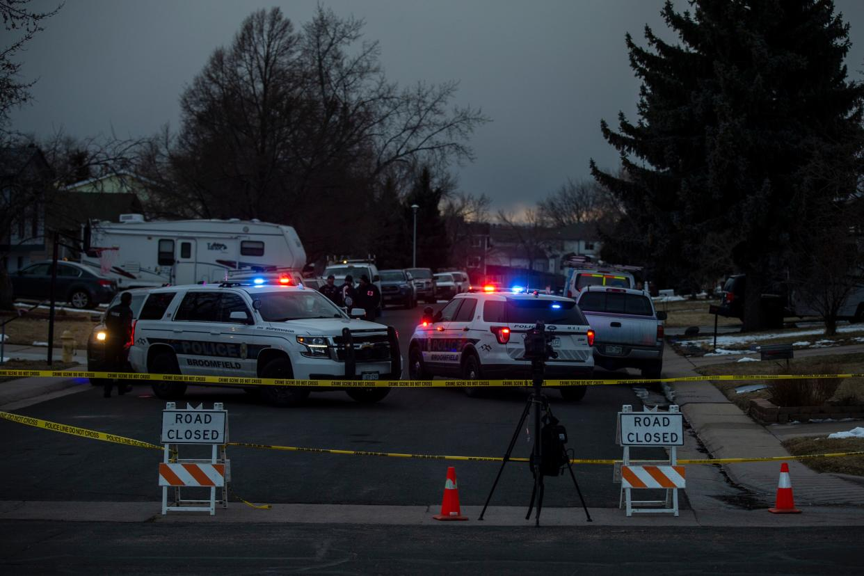 Police tape blocks a street where debris fallen from a United Airlines airplane's engine lay scattered through the neighborhood of Broomfield, outside Denver, Colorado, on February 20, 2021. - A United Airlines flight suffered a fiery engine failure February 20, shortly after taking off from Denver on its way to Hawaii, dropping massive debris on a residential area before a safe emergency landing, officials said.