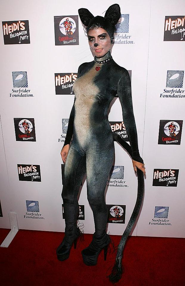 "Meow! Heidi Klum disguises herself as a sexy feline for her annual Halloween party at the Green Door in Hollywood. Jesse Grant/<a href=""http://www.wireimage.com"" target=""new"">WireImage.com</a> - October 31, 2007"