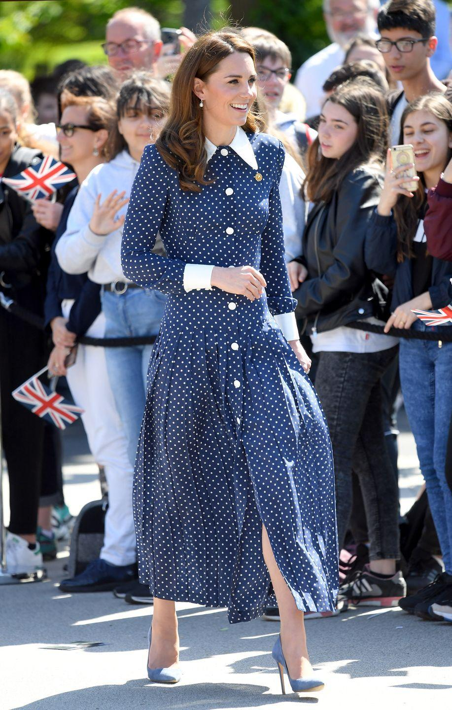 """<p>During a visit to Bletchley Park—the WWII-era facility where codebreakers, including Kate's grandmother, worked to decipher Axis messages—<a href=""""https://www.townandcountrymag.com/style/fashion-trends/a27455668/kate-middleton-alessandra-rich-dress-bletchley-park-d-day-75th-anniversary/"""" rel=""""nofollow noopener"""" target=""""_blank"""" data-ylk=""""slk:the Duchess rewore a navy polka-dot dress from Alessandra Rich"""" class=""""link rapid-noclick-resp"""">the Duchess rewore a navy polka-dot dress from Alessandra Rich</a>. She accessorized the dress with a pin designed to look like a gear from the Enigma machine, a device made at Bletchley Park.</p>"""