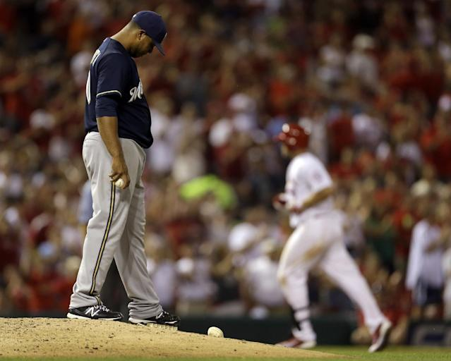 St. Louis Cardinals' Matt Holliday, right, rounds the bases after hitting a two-run home run off Milwaukee Brewers starting pitcher Wily Peralta during the sixth inning of a baseball game Tuesday, Sept. 10, 2013, in St. Louis. (AP Photo/Jeff Roberson)