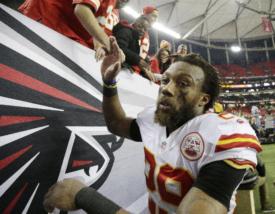 Kansas City Chiefs strong safety Eric Berry (29) greets fans after an NFL football game against the Atlanta Falcons, Sunday, Dec. 4, 2016, in Atlanta. The Chiefs won 29-28. (AP Photo/Chuck Burton)