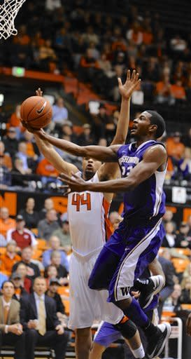 Washington's C.J. Wilcox (23) shoots against Oregon State's Devon Collier (44) during the first half of an NCAA college basketball game in Corvallis, Ore., Wednesday Jan. 23, 2013. (AP Photo/Greg Wahl-Stephens)