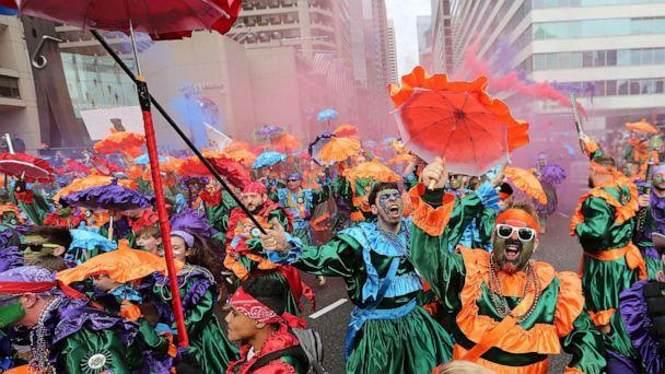 PHOTO: Members of the Saints Wench Brigade strut in front of the judges at City Hall during the Mummers Parade, Jan. 1, 2019, in Philadelphia. (David Maialetti/The Philadelphia Inquirer via AP)