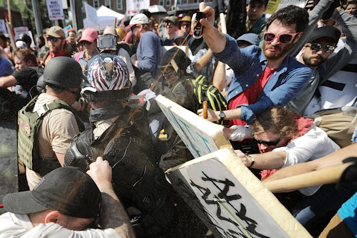 """<p>White nationalists, neo-Nazis and members of the """"alt-right"""" exchange vollys of pepper spray with counter-protesters as they enter Lee Park during the """"Unite the Right"""" rally Aug.12, 2017 in Charlottesville, Va. (Photo: Chip Somodevilla/Getty Images) </p>"""
