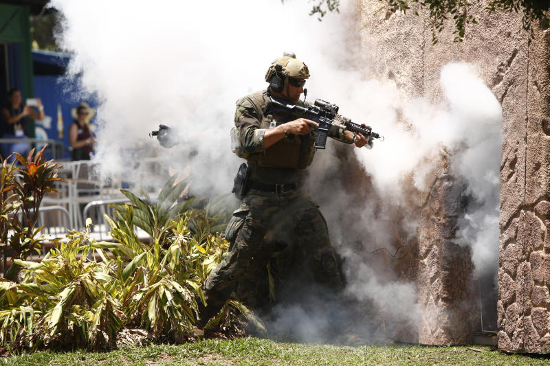 Special operators assault a simulated terrorist building