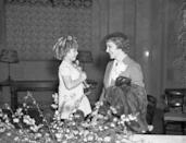 <p>Bring back more hats to the Oscars, please! The star looked way stylish in a blazer, newsboy cap, and coat when she accepted her Best Actress award from none other than Shirley Temple.</p>