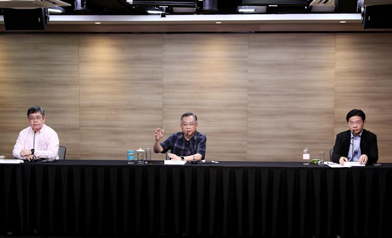 From left to right: Ministry of Health's director of medical services Kenneth Mak, and multi-ministry taskforce chairmen Gan Kim Yong and Lawrence Wong at a weekly virtual press conference on Tuesday (7 July). (Photo: Ministry of Communications and Information)