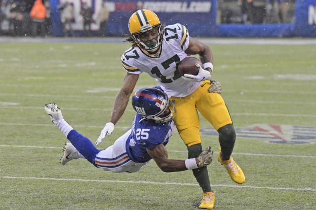 New York Giants' Corey Ballentine, left, tries to tackle Green Bay Packers' Davante Adams during the first half of an NFL football game, Sunday, Dec. 1, 2019, in East Rutherford, N.J. (AP Photo/Bill Kostroun)