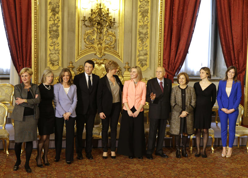 Italian President Giorgio Napolitano, fourth from right, poses for a family photo with Premier Matteo Renzi, fourth from left, and the women ministers of his Cabinet, at the end of a swearing in ceremony of the new government at the Quirinale Presidential Palace, in Rome, Saturday, Feb. 22, 2014. From left, Economic Development Minister Federica Guidi, Education Minister Stefania Giannini, Health Minister Beatrice Lorenzin, Renzi, Defense Minister Robeta Pinetti, Foreign Minister Federica Mogherini, President Napolitano, Regional Affairs Minister Maria Carmela Lanzetta, Semplification and Public Administration Minister Marianna Madia, and Relations with Parliament Minister Maria Elena Boschi. (AP Photo/Andrew Medichini)