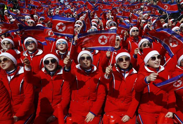 Alpine Skiing - Pyeongchang 2018 Winter Olympics - Men's Slalom - Yongpyong Alpine Centre - Pyeongchang, South Korea - February 22, 2018 - North Korean cheerleaders wave flags. REUTERS/Kai Pfaffenbach