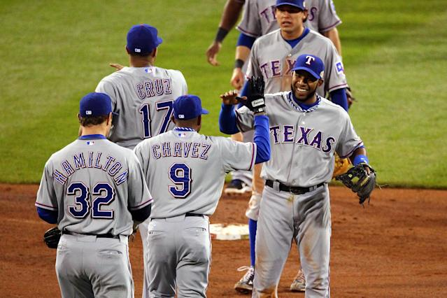 ST LOUIS, MO - OCTOBER 20: Endy Chavez #9 and Elvis Andrus #1 of the Texas Rangers celebrate after defeating the St. Louis Cardinals 2-1 during Game Two of the MLB World Series at Busch Stadium on October 20, 2011 in St Louis, Missouri. (Photo by Dilip Vishwanat/Getty Images)