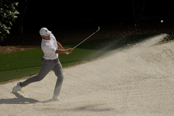 Xander Schauffele hits out of a bunker on the fifth hole during the final round of the Masters golf tournament on Sunday, April 11, 2021, in Augusta, Ga. (AP Photo/Gregory Bull)