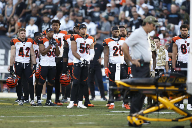The Cincinnati Bengals look on as Bengals wide receiver Auden Tate is carried off the field after an injury during the second half of an NFL football game against the Oakland Raiders in Oakland, Calif., Sunday, Nov. 17, 2019. (AP Photo/D. Ross Cameron)
