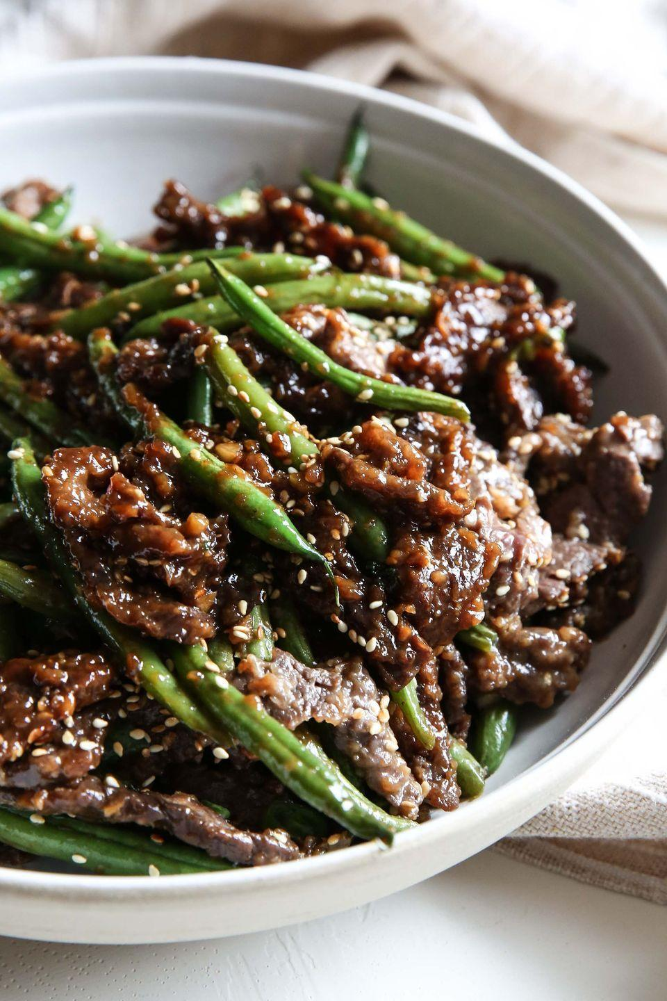 """<p>This is the most flavorful a stir-fry could ever be.</p><p>Get the recipe from <a href=""""/cooking/recipe-ideas/recipes/a51791/sesame-ginger-beef-recipe/"""" data-ylk=""""slk:Delish"""" class=""""link rapid-noclick-resp"""">Delish</a>.</p>"""