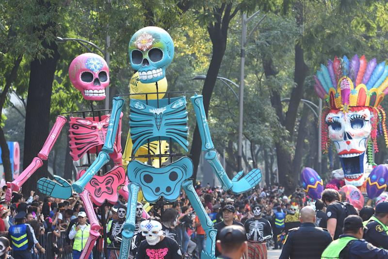 People are seen participating in Day of the Dead celebrations in Mexico City on Saturday.