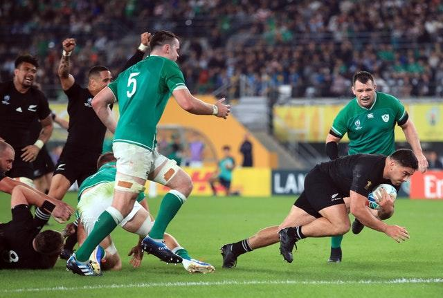 New Zealand's Codie Taylor (second right) runs in to score his side's fourth try during the 2019 Rugby World Cup Quarter Final match at Tokyo Stadium.