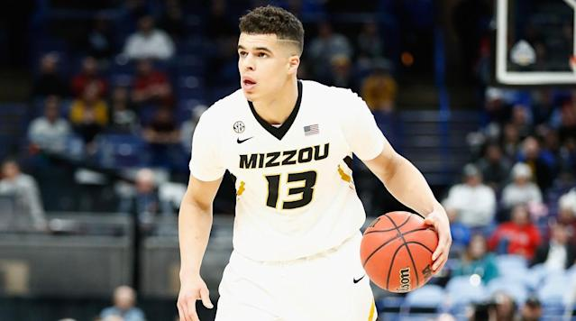 "<p>NASHVILLE, Tenn. — Michael Porter Jr. had nothing to prove. Before resuming his college career at Missouri earlier this month, he had already demonstrated he was one of the top teenage basketball players on the planet. He had already hinted at his potential to blossom into an NBA franchise-altering star. He was, in short, a sure thing.</p><p>Porter Jr. garnered five-star ratings from recruiting services, led his high school team to a 29-0 record and state championship, and was named the Most Valuable Player of the McDonald's All-American Game. <em>Sports Illustrated</em> projected him as the leading freshman scorer in the country, and the Southeastern Conference anointed him its preseason co-player of the year. His experience with USA basketball and performance at other high-profile events gave NBA scouts an extensive file to work with before he ever set foot on campus. Porter Jr. probably could have sat out the season without worrying about falling out of the top 10 picks in the upcoming draft.</p><p>Instead, there was Porter Jr., taking the floor last week in the second round of the SEC tournament against Georgia. As Porter Jr. came off the bench to replace junior forward Kevin Puryear with less than three minutes off the clock, a pro-Tigers crowd at the Scottrade Center in St. Louis roared its approval at the sight of the most highly touted recruit in program history entering a low-stakes game for a team already on safe ground for an at-large bid to the NCAA tournament. Porter was removed less than two minutes into Missouri's season opener against Iowa State with what was initially thought to be a hip injury, and it was later announced that he would undergo spinal surgery, a procedure that was presumed to sideline him for the remainder of his freshman campaign.?</p><p>Fast-forward to mid-March and the smooth-scoring, 3-and-D prototype drawing Kevin Durant comparisons was playing for Missouri again, but it wasn't exactly clear why. From an outsider's perspective, his 11th-hour return was as enigmatic as it was exciting.</p><p>On Thursday, a day before the No. 8 seed Tigers face No. 9 Florida State in a tourney opener that could well double as Porter Jr.'s final college game, he tried to explain. Seated in the corner of a locker room here at Bridgestone arena, Porter Jr. attracted a herd of reporters wide enough to effectively create a blockade around the entrance. He stared at a wall of cameras and microphones while fielding questions about a decision in which the risks seemingly far outweigh the rewards. Porter Jr. was asked how much he thought about his NBA future in reaching that decision.</p><p>""That's what everybody else was talking about,"" Porter Jr. said. ""But in my mind, that really wasn't an issue. I know how I'll be able to play in the NBA."" What pushed Porter Jr. back into action, as he tells it, was something much simpler. ""I just wanted to—if I could help the team—help the team.""</p><p>Porter Jr.'s father, Michael, provided more context around the decision. The elder Porter clarified that it was ""100% [Porter Jr.'s] decision"" and mentioned that ""Mike would have been fine if he did move on from here—he would have been fine at the next level not having played at all this year, but he, like I said, grew close to this group of guys and wanted to be with them during this time."" What lies ahead for his son was hardly a non-factor, but at the same time, neither was what's happening right now—what Porter Jr. can't get back once he jumps to the pros. ""If you want to play, and you want to help these guys, then let's do it,"" the elder Porter said. ""Don't second guess it, don't look back, be all in and go play.""</p><p>When Porter Jr. does suit up for the Tigers on Friday, it will mark the culmination of a journey that was hardly typical for an elite prospect in the one-and-done era. Missouri did not have to recruit Porter Jr. so much as it had to pave the way for his homecoming. Porter had lived with his family in Columbia, Mo., while his father served as an assistant coach under his sister-in-law, Robin Pingeton, on the Tigers' women's team. In May 2016, the elder Porter was hired to a position on the staff of then-Washington head coach Lorenzo Romar, Porter Jr.'s godfather. A move to Seattle followed, and Porter Jr. verbally committed to the Huskies that summer. The following spring, after Washington fired Romar, Porter Jr. was granted his release from the Huskies, and his father agreed to become an assistant for new Tigers head coach Cuonzo Martin. Porter Jr. announced the same week that he was headed to Missouri.</p><p>In revealing his commitment to the Tigers, Porter Jr. exclaimed in a social media post, ""MIZZOU NATION I'M COMING HOME!!!"" and wrote that he and his teammates hoped ""to restore the atmosphere at Mizzou arena."" Porter <a href=""http://www.stltoday.com/sports/college/mizzou/porter-is-blazing-a-trail-toward-stardom/article_e250b1f8-2e25-5eea-92ae-1c0aa423b27c.html"" rel=""nofollow noopener"" target=""_blank"" data-ylk=""slk:already knew"" class=""link rapid-noclick-resp"">already knew</a> what it felt like to play in that building, and his goal didn't feel unreasonable considering the roster makeover Martin engineered in the space of one offseason. In addition to adding Porter and his younger brother, Jontay—himself a top-25 player in the class of 2017—Martin added two other four-star recruits (power forward Jeremiah Tilmon and point guard Blake Harris, who has since transferred) and a coveted graduate transfer (Canisius's Kassius Robertson). The Tigers did not look like the SEC's best team, but they weren't far behind.</p><p>The possibility of a Porter-fueled revival for a program that had spent the previous three seasons languishing in the high-major cellar went up in flames less than a month into the season. As conflicting details about the nature of Porter Jr.'s injury trickled out in the days following the Tigers' opener against Iowa State, on Nov. 21 the program provided clarity on the situation by announcing Porter Jr. would likely miss the rest of the season after undergoing a microdiscectomy of the L3-L4 spinal discs.</p><p>It soon became clear Porter Jr. had other ideas. In late November, a message posted to Porter Jr.'s Instagram account implied that he intended to beat the projected timeline for his recovery. ""Just letting y'all know,"" read the post, which included two emojis with raised eyebrows. ""Whoever said it was gonna take 3-4 months to recover lied."" The next month, Porter Jr. gave an interview during a broadcast of a game against Illinois in which he said he was ""feeling great"" and ""getting stronger every day."" In February, Porter Jr. told reporters there was a ""good chance"" he would play again this season, and he was cleared to return to practice later that month, but he didn't play in any of Missouri's remaining regular-season games.</p><p>That left the SEC tournament for Porter Jr. to get in a tune-up before the NCAAs. Less than a week after <a href=""http://www.kansascity.com/sports/spt-columns-blogs/vahe-gregorian/article204009829.html"" rel=""nofollow noopener"" target=""_blank"" data-ylk=""slk:telling Martin"" class=""link rapid-noclick-resp"">telling Martin</a> that he was ""ready to go,"" Porter came off the bench at the 17:22 mark of Missouri's postseason opener against Georgia. He spent 23 minutes dusting off the cobwebs formed by four months sitting out of regulation competition. About six minutes into the first half, Porter Jr. posted up a defender and back-rimmed a contested turnaround jumper. A few minutes later, he came flying off a screen at the top of the key and set his feet, only to air ball a catch-and-shoot three-point attempt. Early in the second half, he tried to blow by Georgia big man Yante Maten off the dribble but his layup attempt swatted away.</p><p>After finishing with only 12 points on a game-high 17 shots, <a href=""http://www.kansascity.com/sports/college/sec/university-of-missouri/article204239714.html"" rel=""nofollow noopener"" target=""_blank"" data-ylk=""slk:Porter Jr. conceded"" class=""link rapid-noclick-resp"">Porter Jr. conceded</a> what was obvious to anyone who had seen him play before he got to Missouri: he was ""not 100% yet."" Porter Jr.'s return was appointment viewing for college hoops diehards, NBA talent evaluators and supporters of lottery-bound franchises, but no reasonable observer should have used one 23-minute sample after a long layoff to meaningfully revise their opinion of Porter's ability, particularly one in which he plainly wasn't at full strength.</p><p>The Tigers' game on Friday is another data point, but not one that, in itself, will cause him to fly up or plummet down draft boards. In any event, Porter Jr. should get a lot of run: Senior forward Jordan Barnett's suspension over a DWI arrest reduced Missouri to seven scholarship players.</p><p>Porter Jr. should be equipped to handle a bigger playing-time load, though he made clear that it'll be a while before he's able to display the form that could convince some NBA general manager to take a shot on him near the top of the first round. ""Even at this point,"" Porter Jr. said, ""my mind's telling me I want to do some certain things that my body just won't be able to do for a couple more months.""</p><p>You will not see the best version of Porter Jr. on Friday. You may not even see a version than can lead the Tigers to a win over an unremarkable Seminoles squad that's dropped three of its last four games. In Porter Jr.'s eyes, that is preferable to the alternative in this tourney: not seeing him at all.</p>"